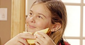 Kid Eating The Amazing Chickpea Butter Sandwich